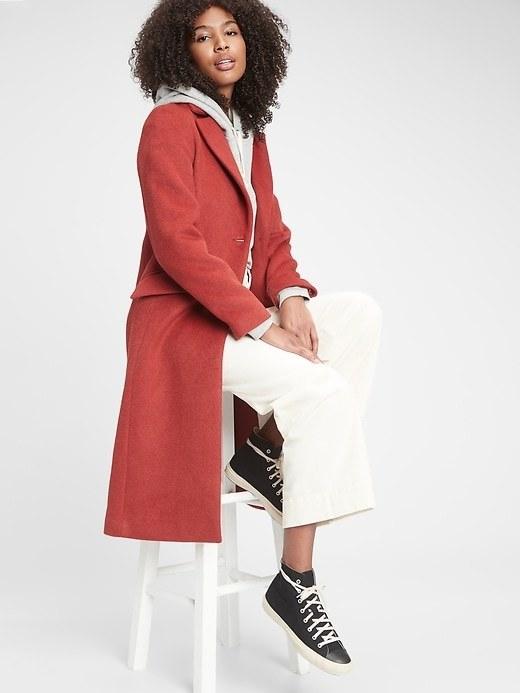 model wearing the hot pink coat