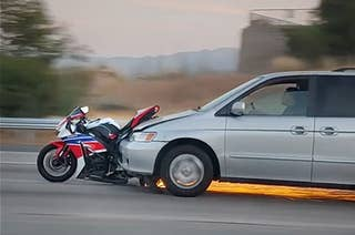 A minivan that hit a motorcycle on the highway
