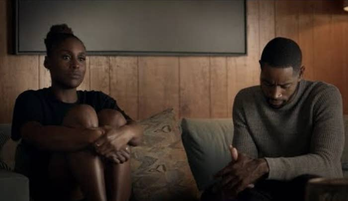 Insecure's Issa Rae on couch with Lawrence looking pensive