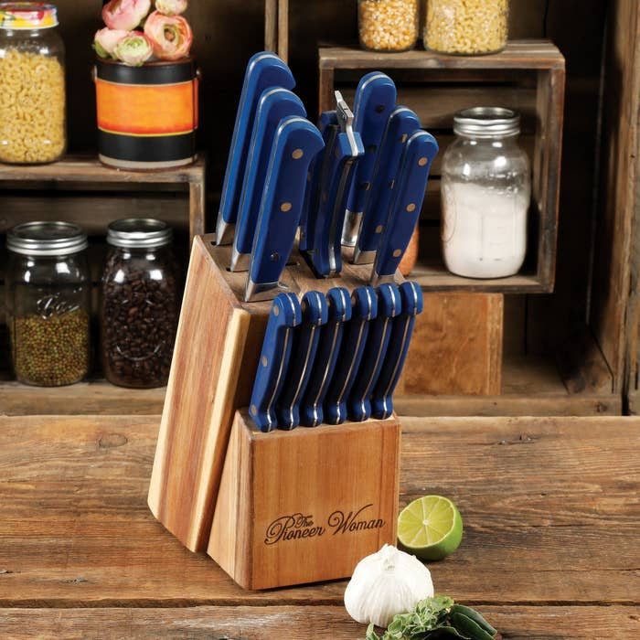 the set of knives in blue displayed in a wooden box with the pioneer woman engraved on it