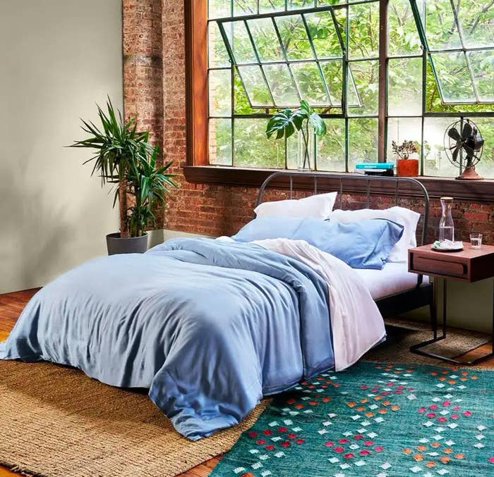 blue eucalyptus sheets on a bed