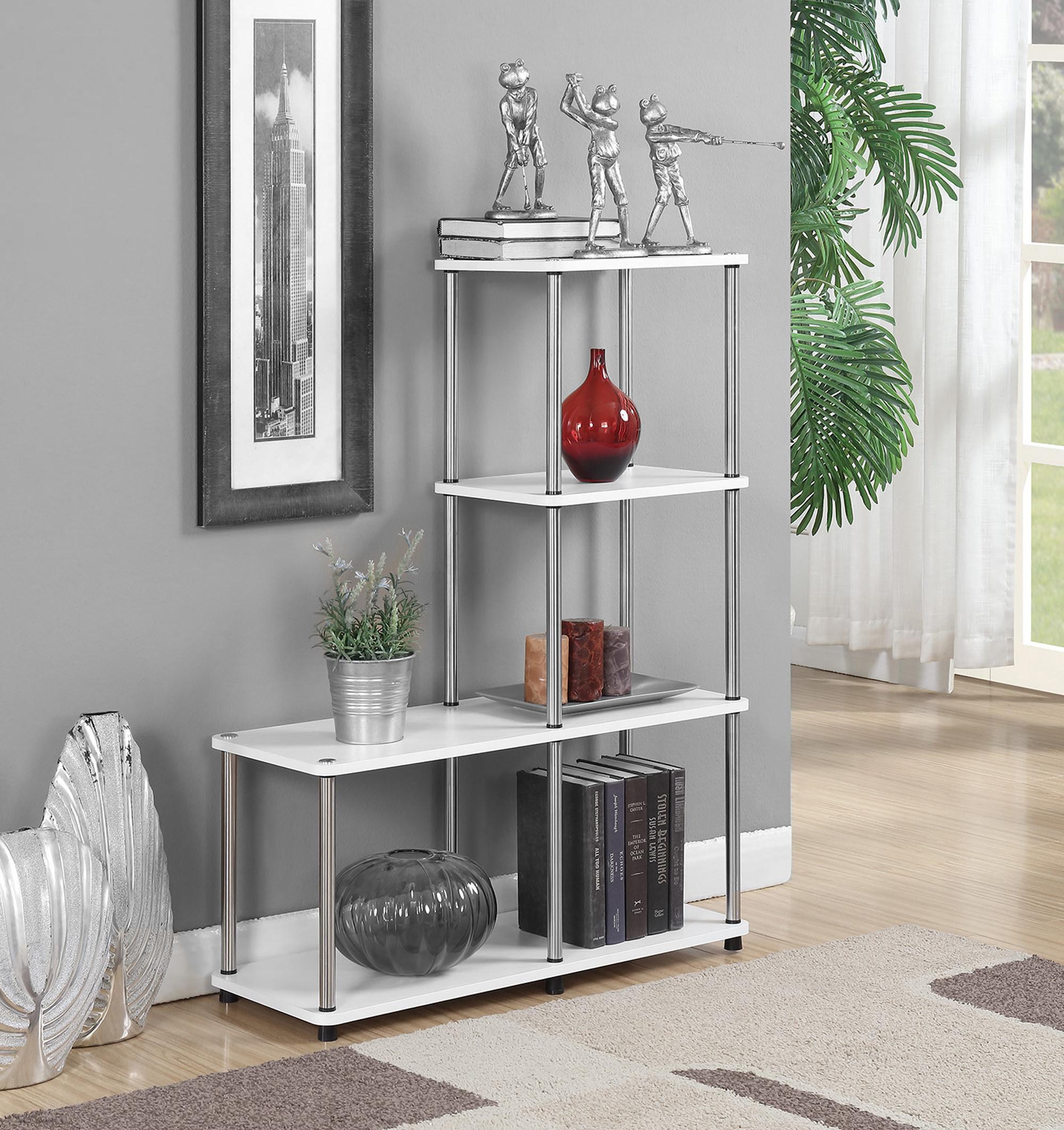 the bookshelf with metal poles and white shelves