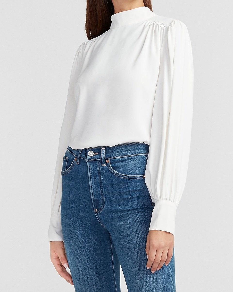 model wearing the white shirt