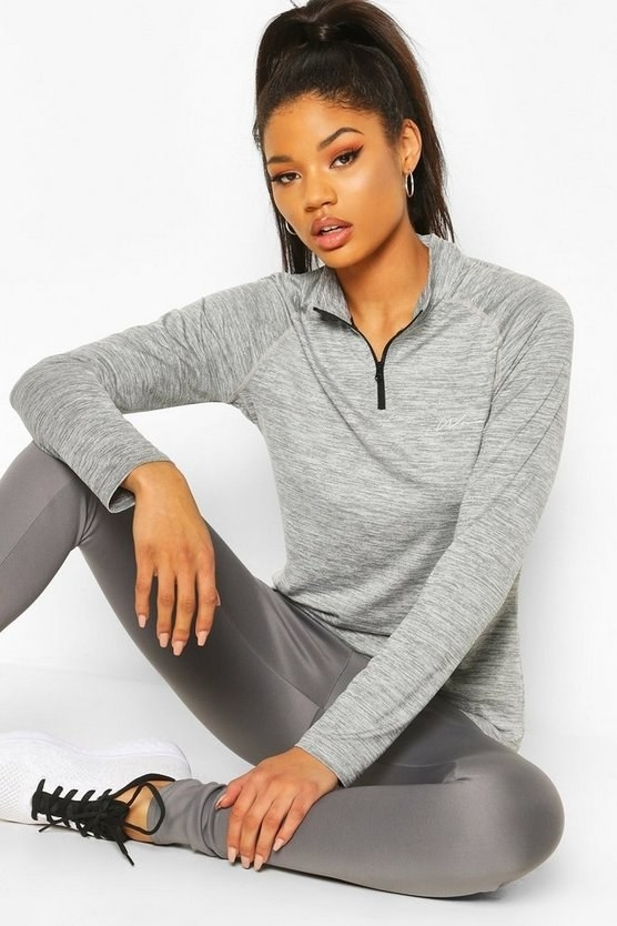 a model wearing the top in gray