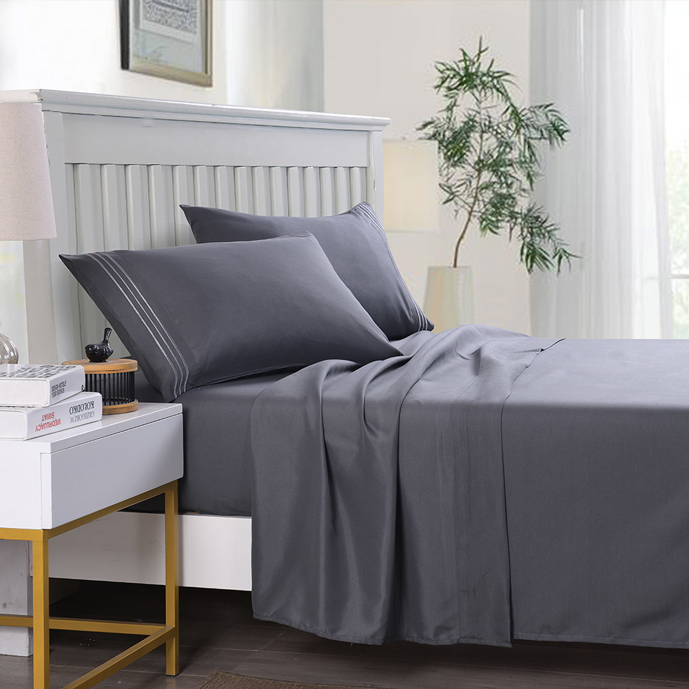 the sheet set in gray on a bed