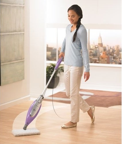A model using the mop on a hardwood floor