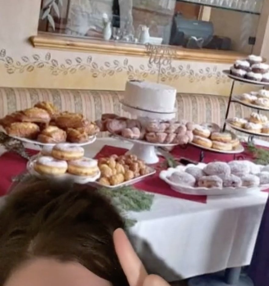 A table filled with many types of donuts