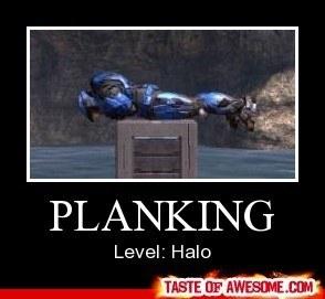 Halo character laying flat atop a box