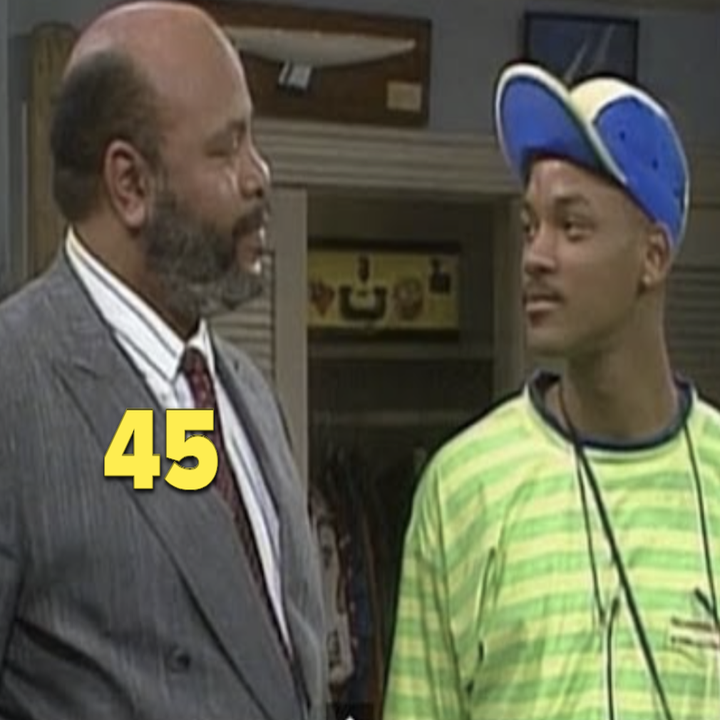 Uncle Phil looking at Will, who's wearing a neon-green shirt and a blue hat