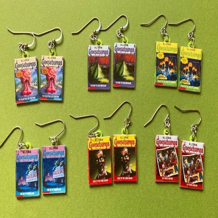 six pairs of earrings with different Goosebumps books designs