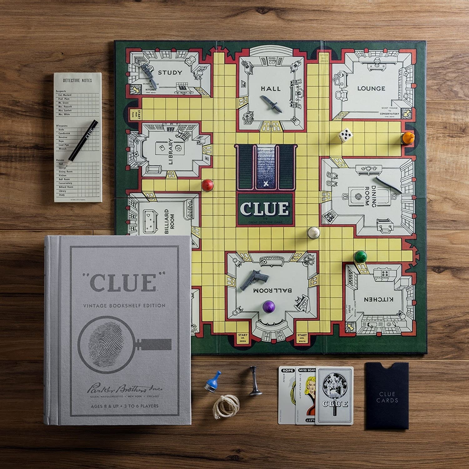 The board game and pieces, plus the grey book cover storage
