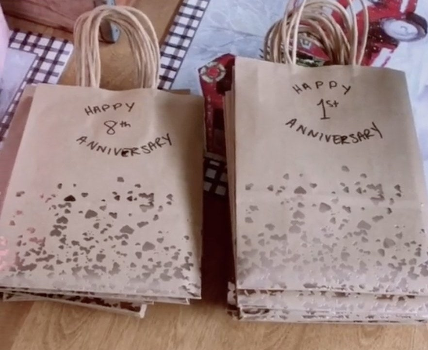 Paper bags filled with anniversary cards