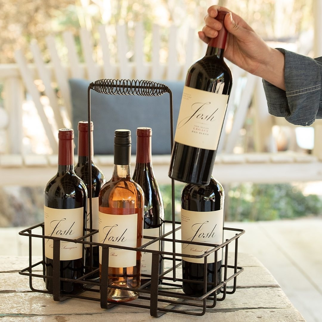 a crate of six bottles of wine