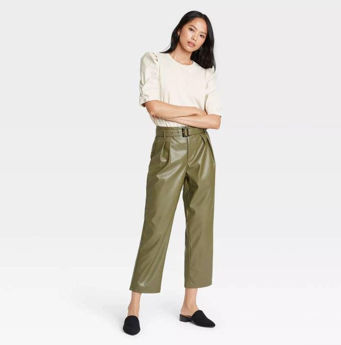 Model wearing the pants in green