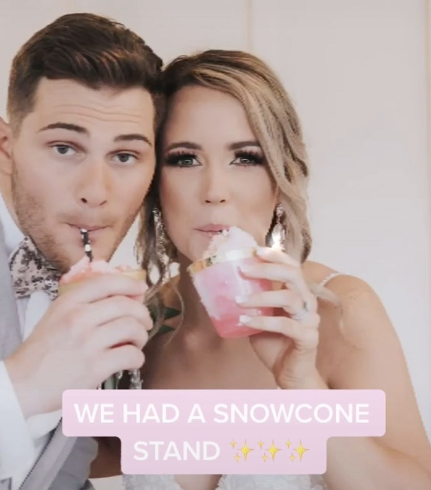 A couple enjoying snowcones