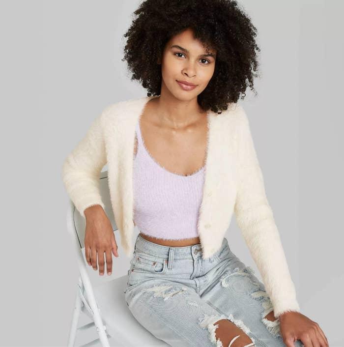 Model wearing the cardigan in cream