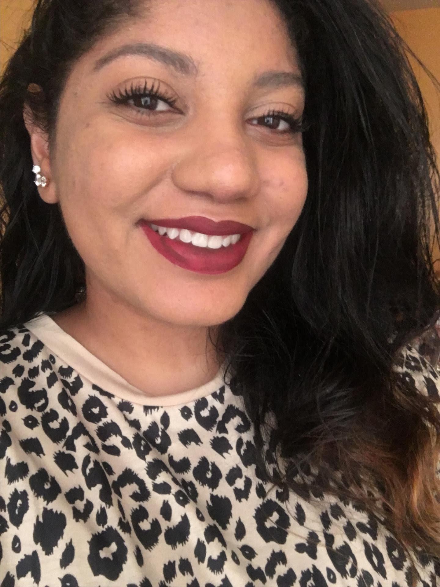buzzfeed writer in dark red matte lipstick