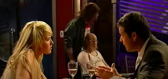 Matt Lucas and David Williams as Lou and Andy in the background of a Neighbours scene