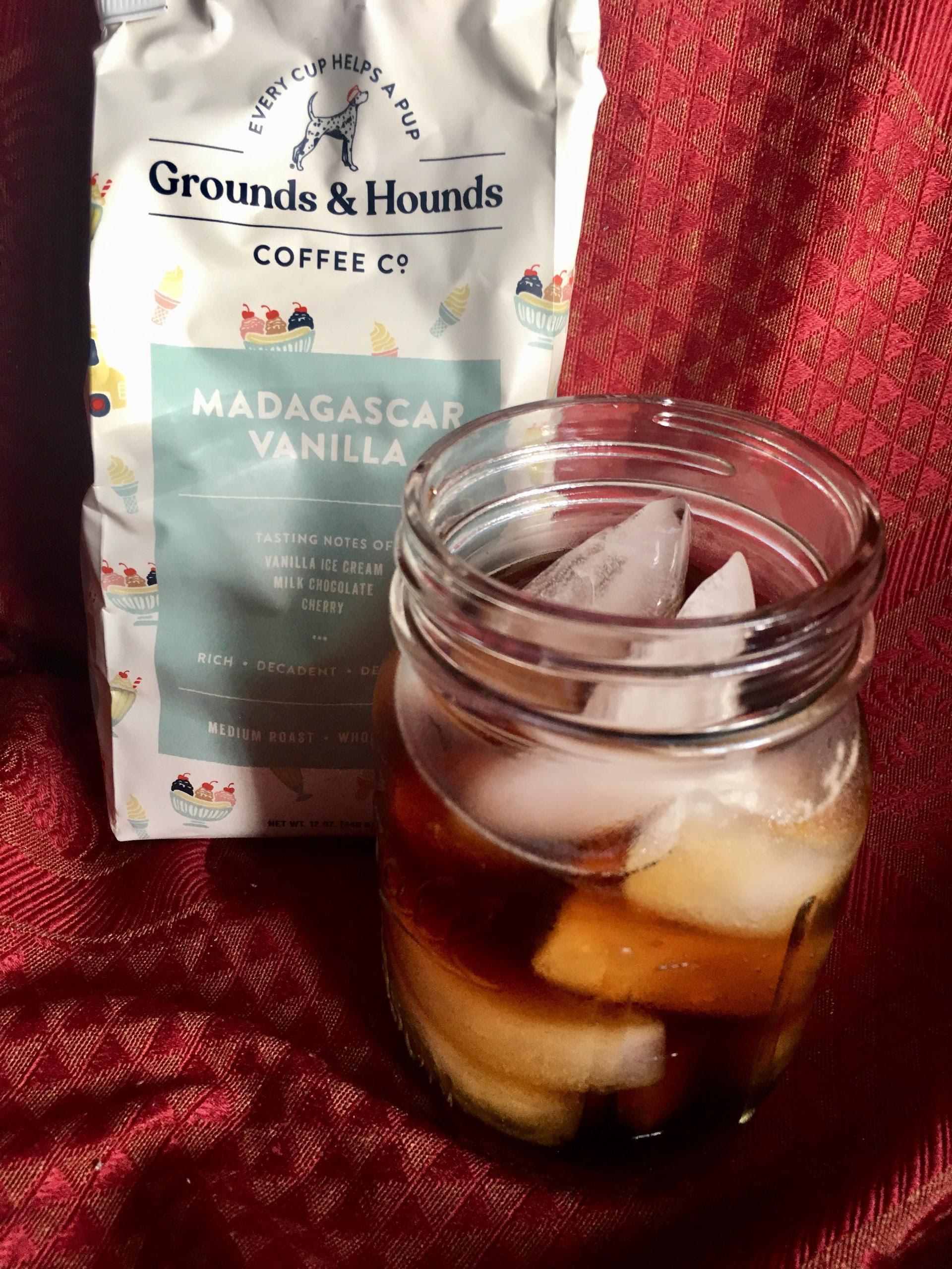 bag of coffee next to an iced coffee