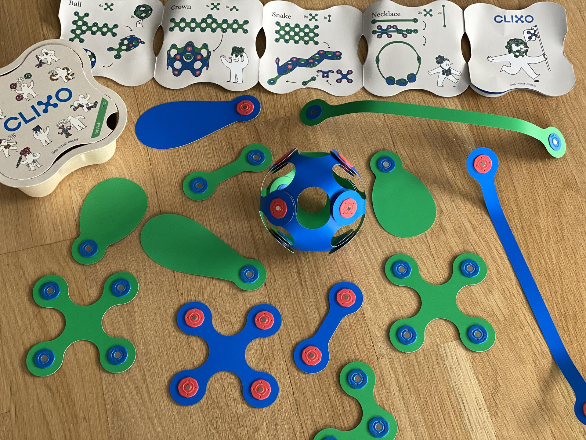 the flexible plastic and magnetic toys, some stuck together and gently bent to form a sphere