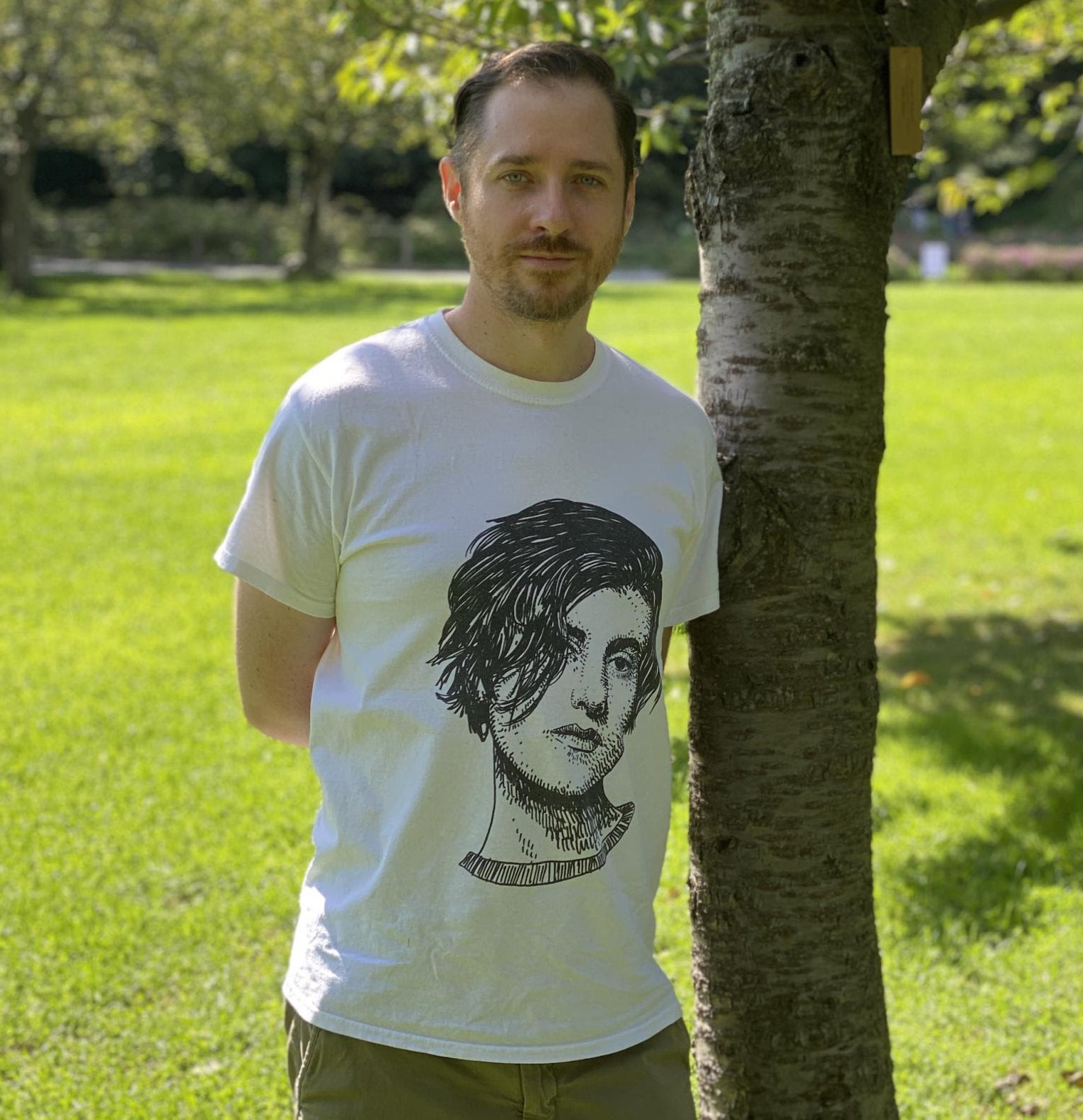 john wearing a t-shirt printed with an illustration of Justine Frischmann