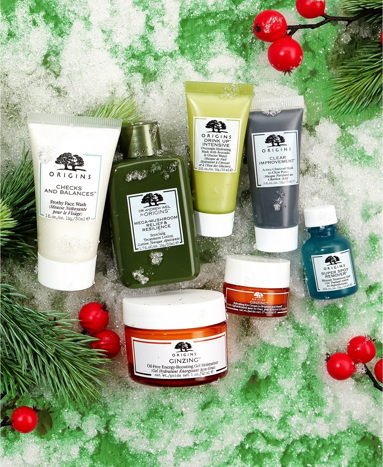 Seven bottles of Origins skin care products on a holiday background