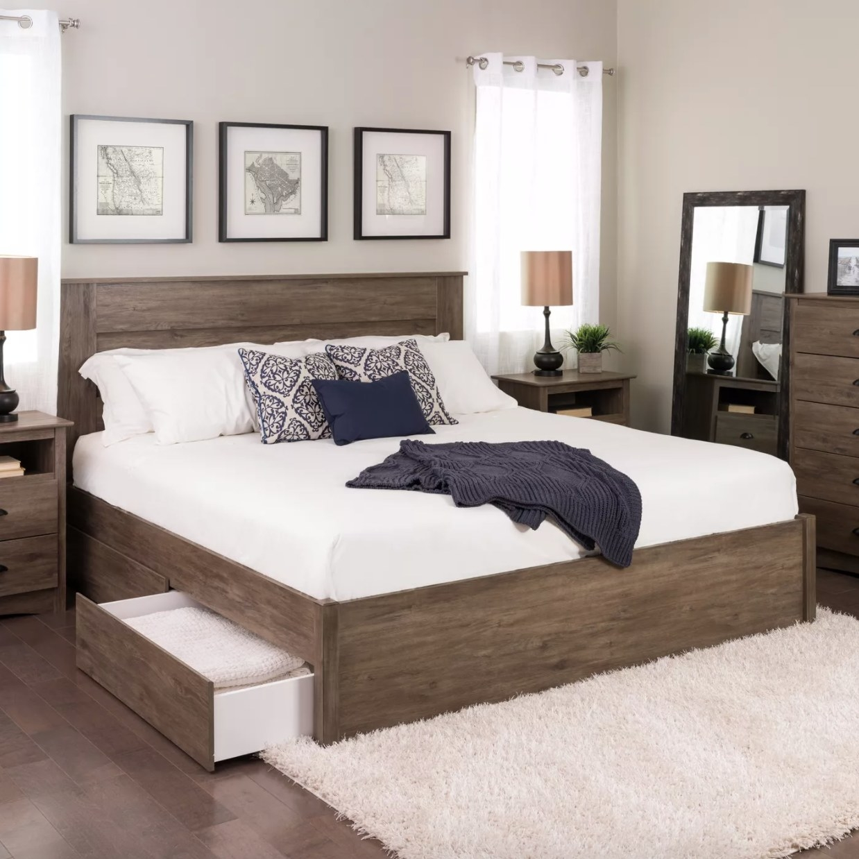 A wooden bed frame with two drawers