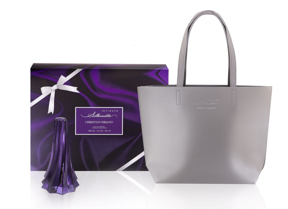 Gift box next to bottle of Christian Siriano perfume and gray tote bag
