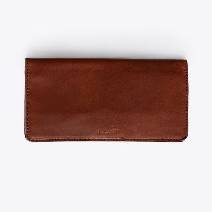 The wallet in a dark chocolate brown color