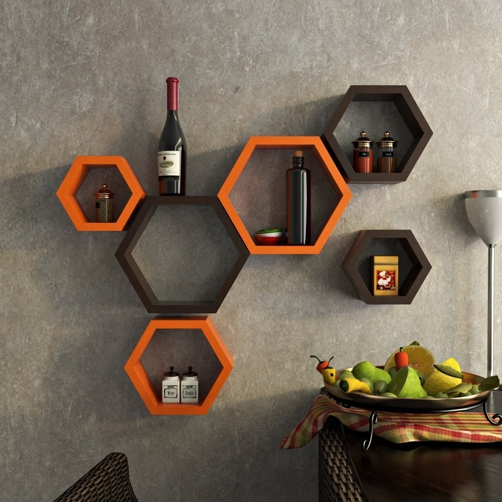 Orange and black hexagonal shelves on a wall