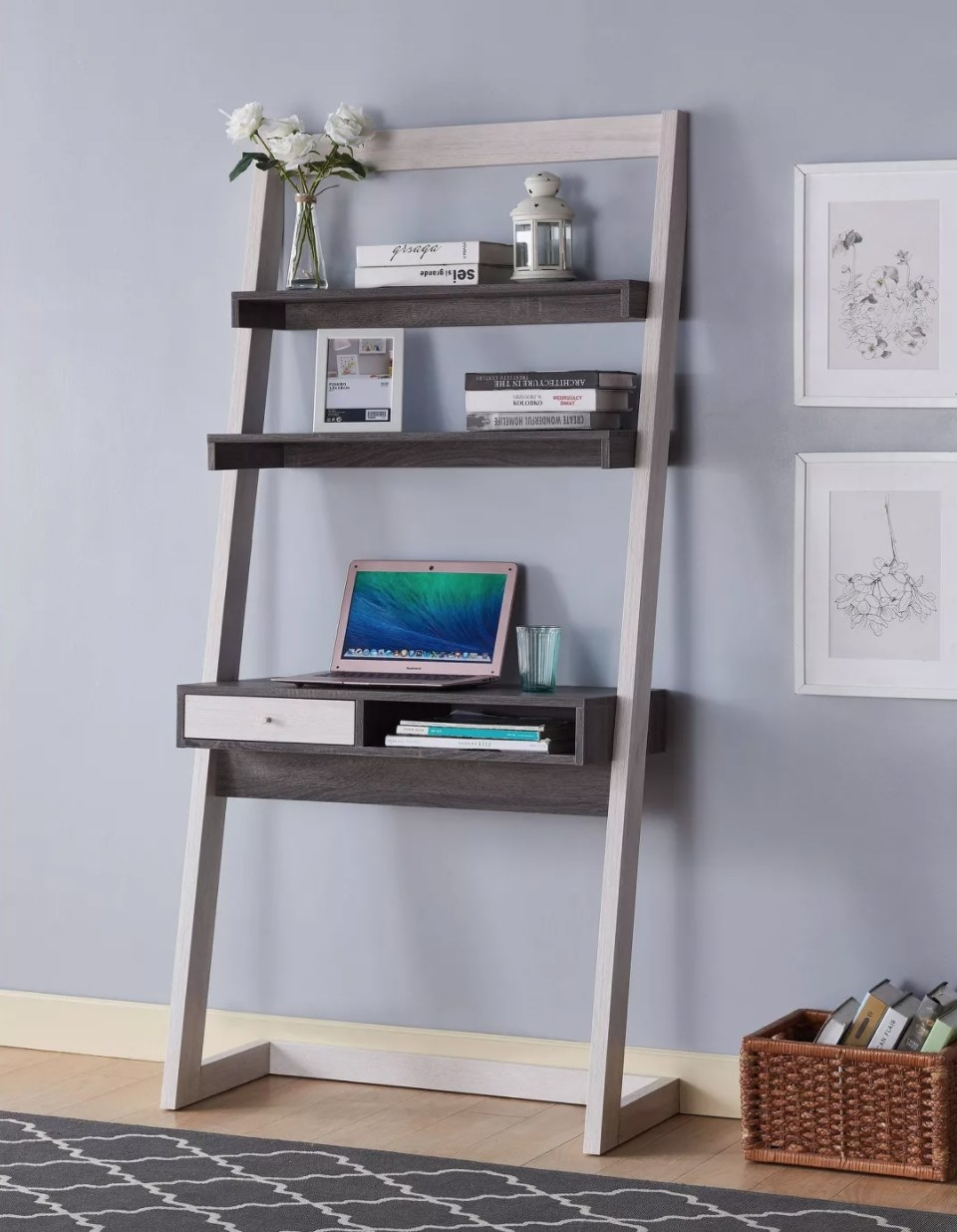 A leaning wooden ladder desk with two shelves in light and dark gray