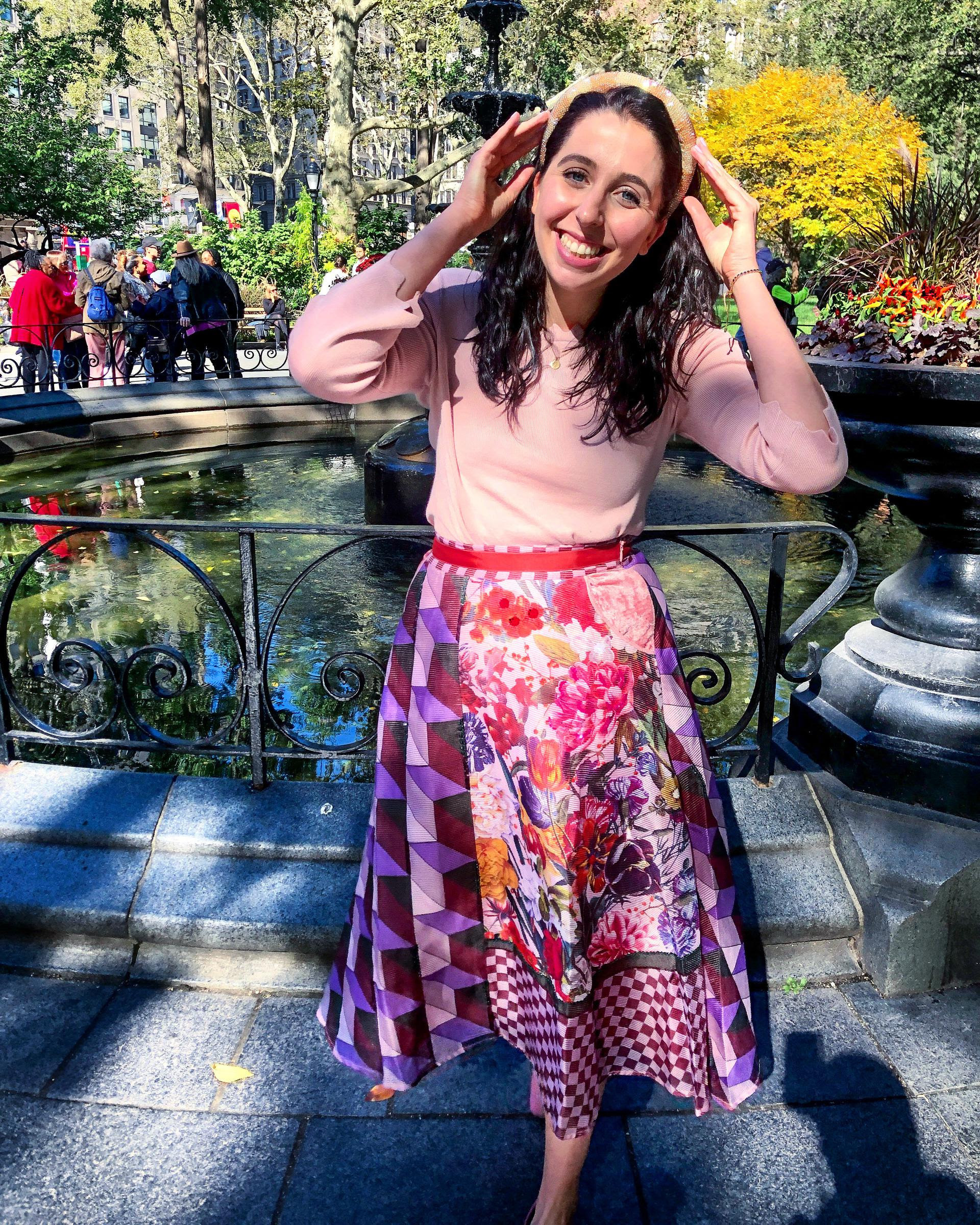 abby posing by a fountain