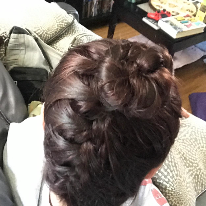 A reviewer used the hairpin to create a braided bun
