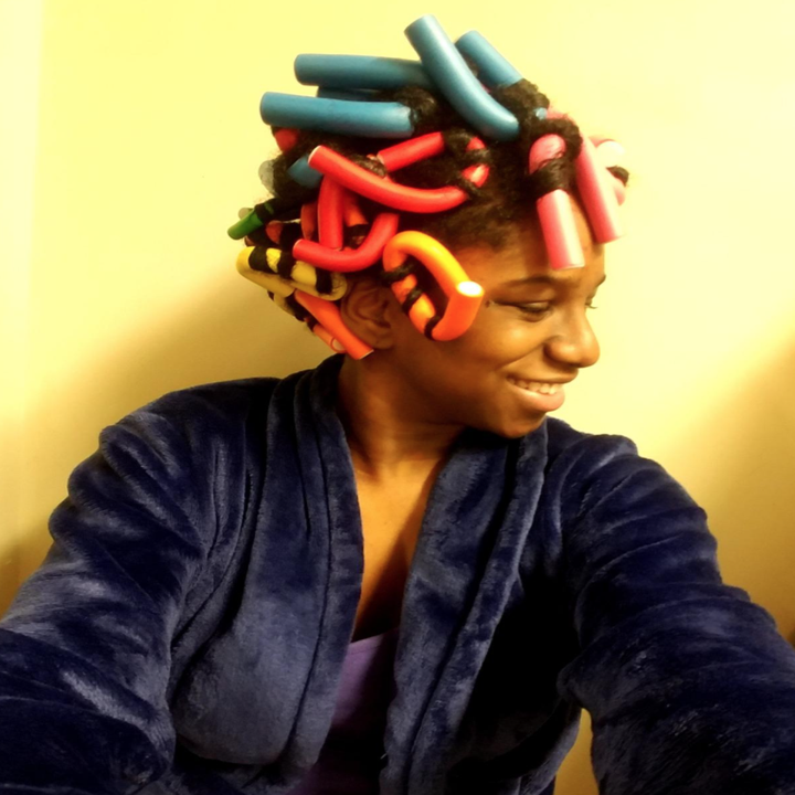 A reviewer with the rods in their hair