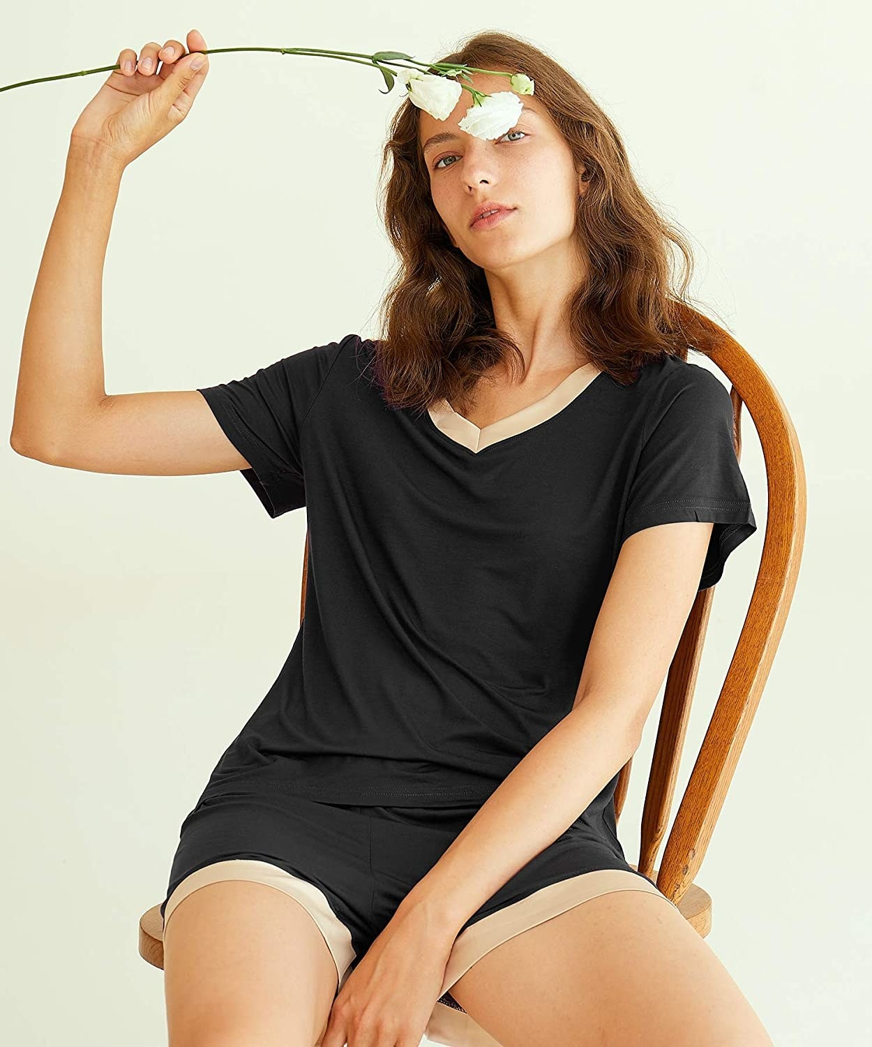Model wearing black t-shirt and short set with cream trim