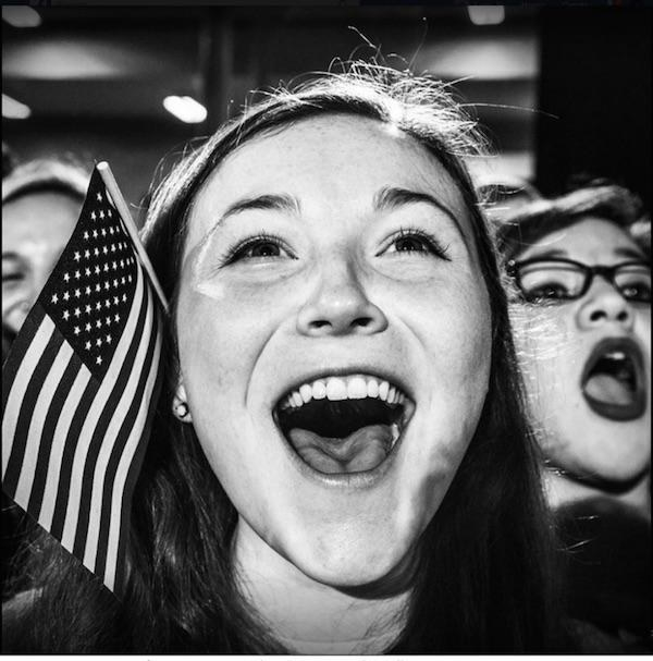 Young girl with American flag screaming in joy