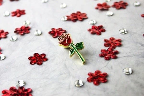 A rose enamel pin