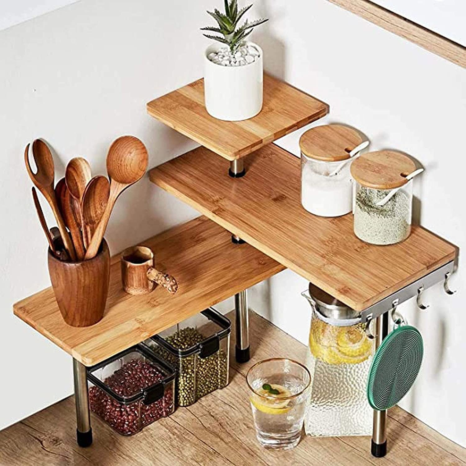 three-tier shelf made with bamboo and metal legs styled on counter