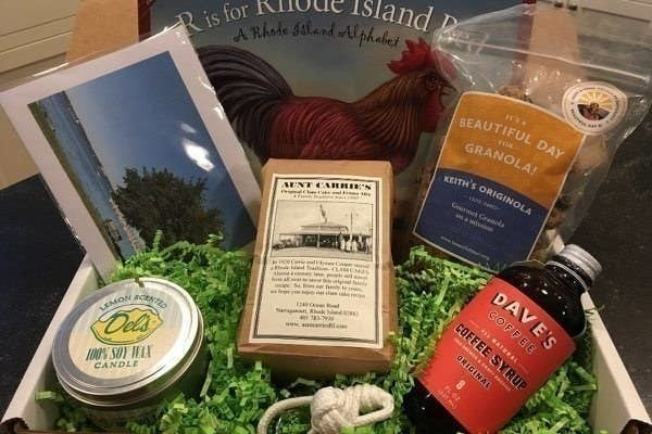 An assortment of goods from Rhode Island including granola, a candle, and coffee syrup