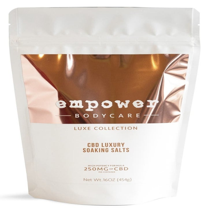 The white and metallic rose gold bag of Empower BodyCare CBD Luxury Soaking Salts