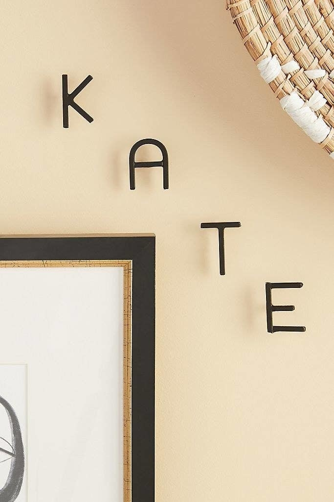 metal letters on the wall that spell kate
