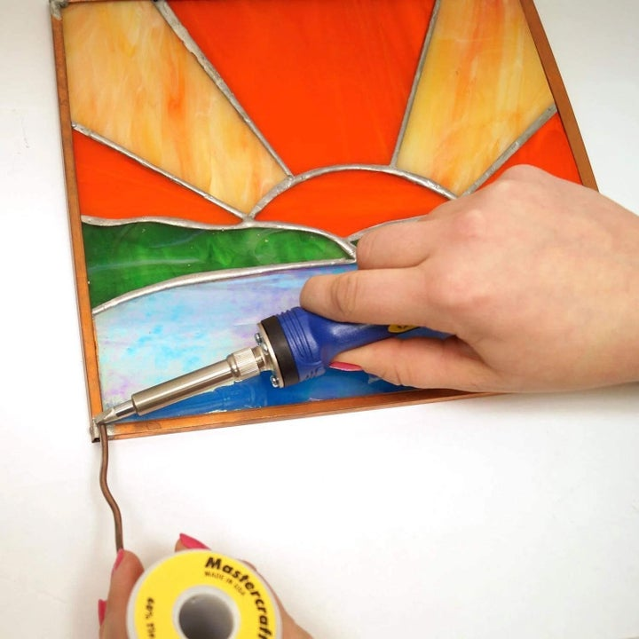 Person putting together pieced window