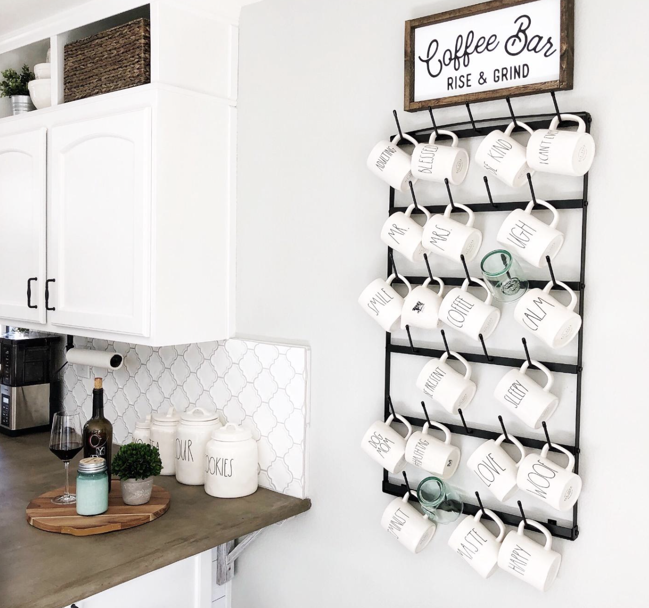 reviewer image of the black rack hung on wall holding tons of mugs