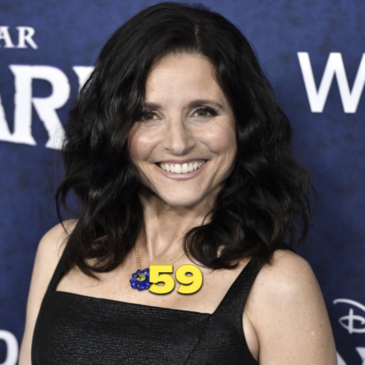 Julia Louis-Dreyfus on the red carpet of an event, wearing a black dress
