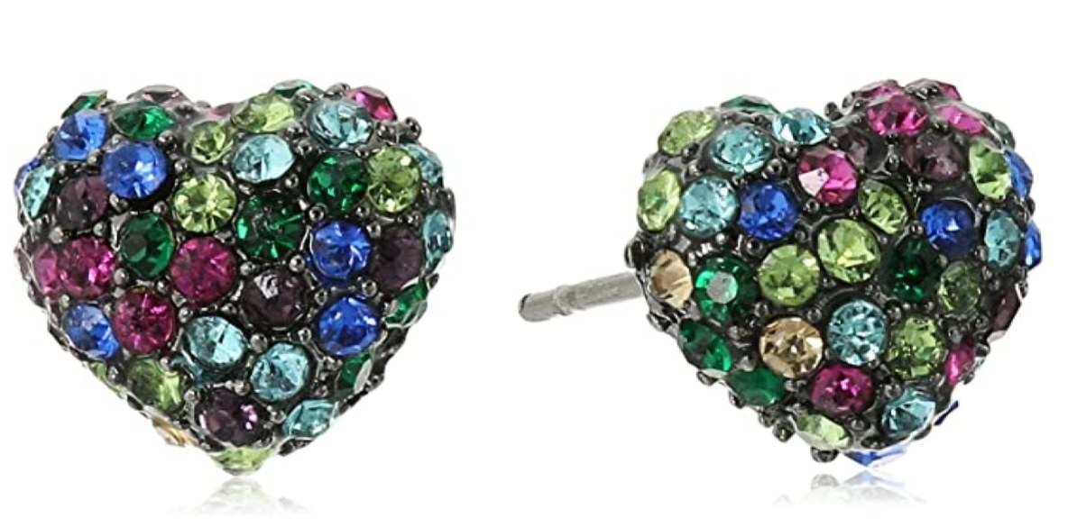a pair of heart shaped stud earrigs encrusted with black purple green blue and gold gems