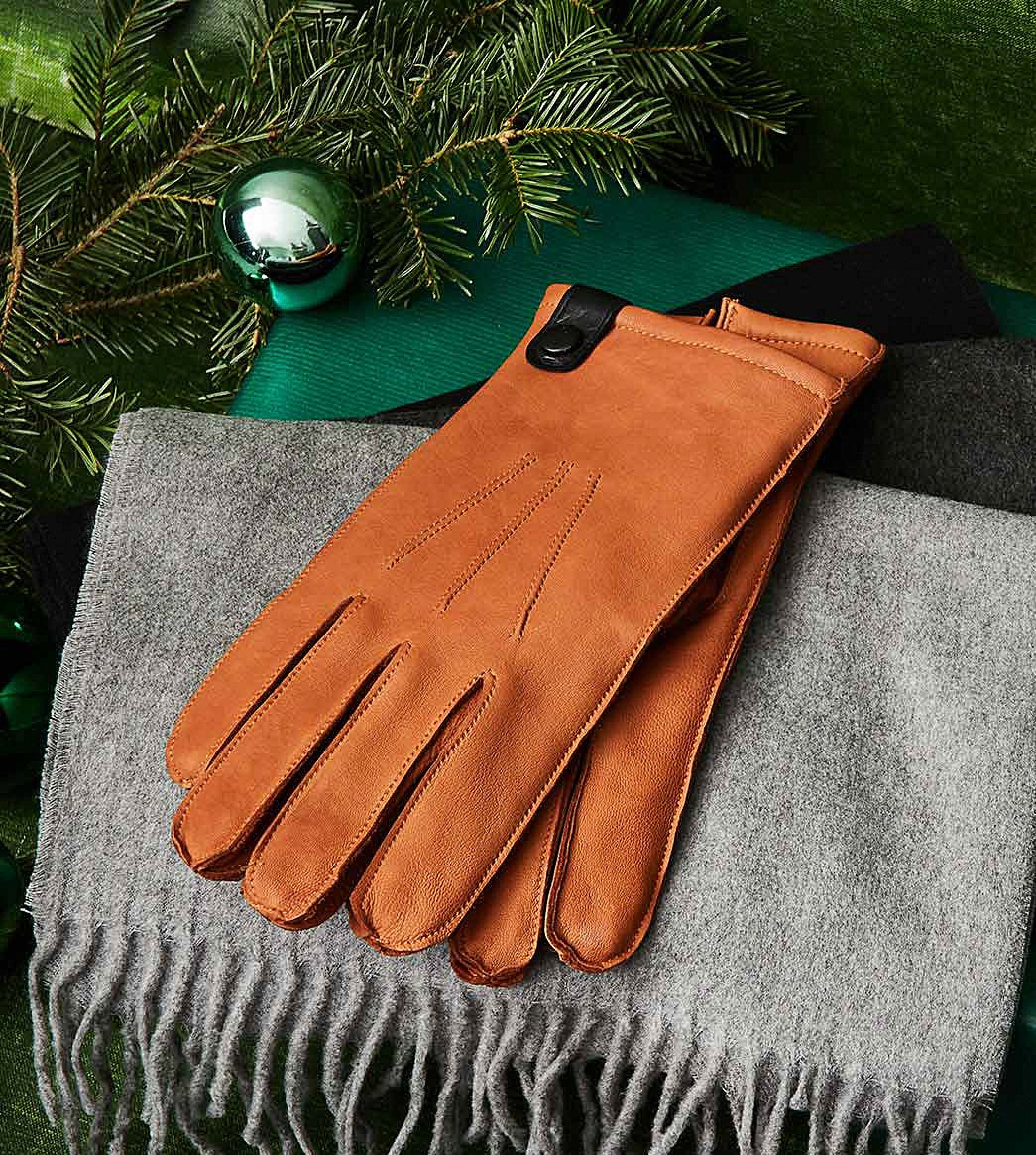 The gloves on top of a scarf