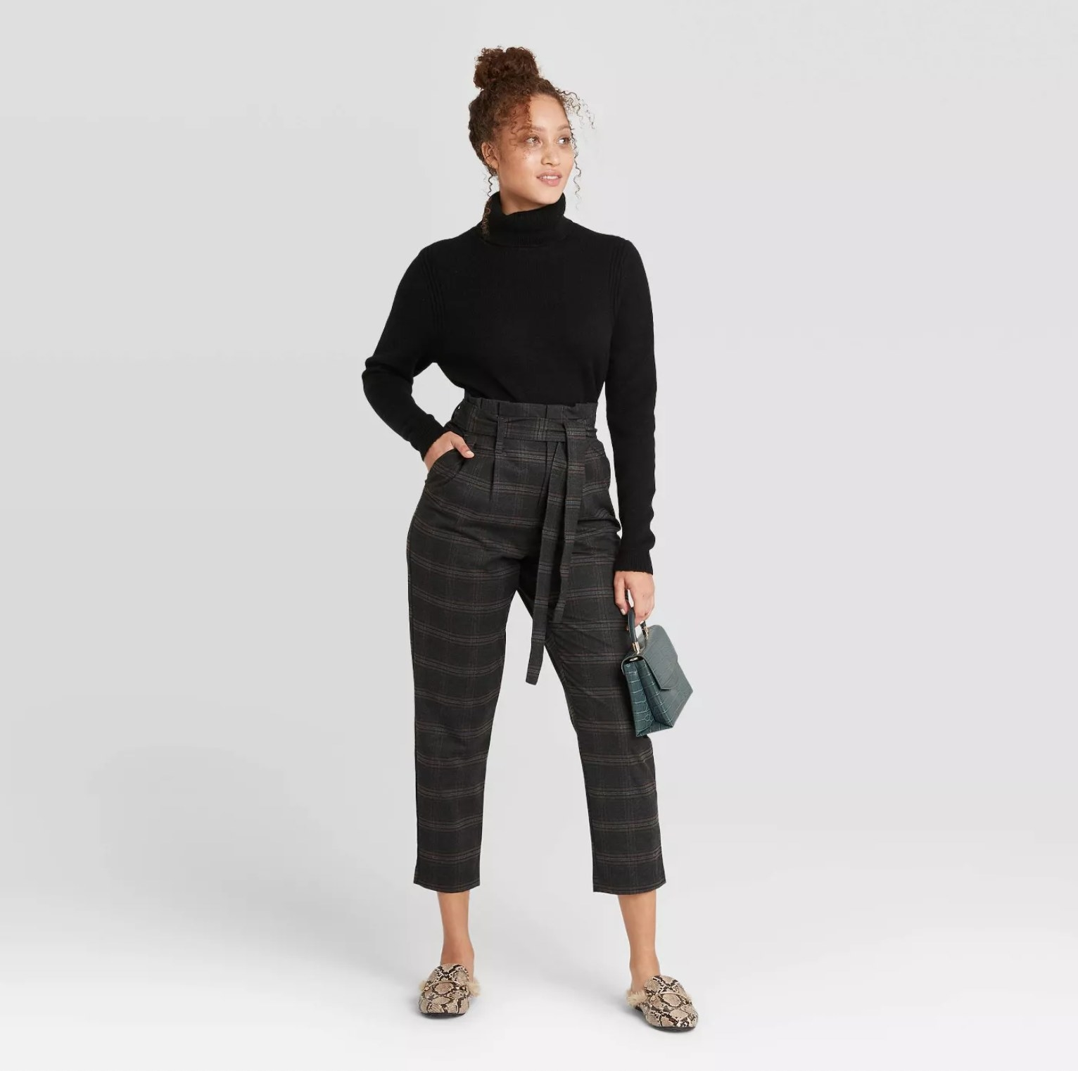 Model wearing the pants in plaid charcoal grey