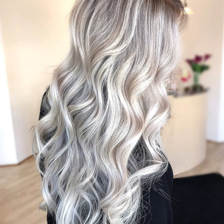 A model with bleached hair that used Olaplex
