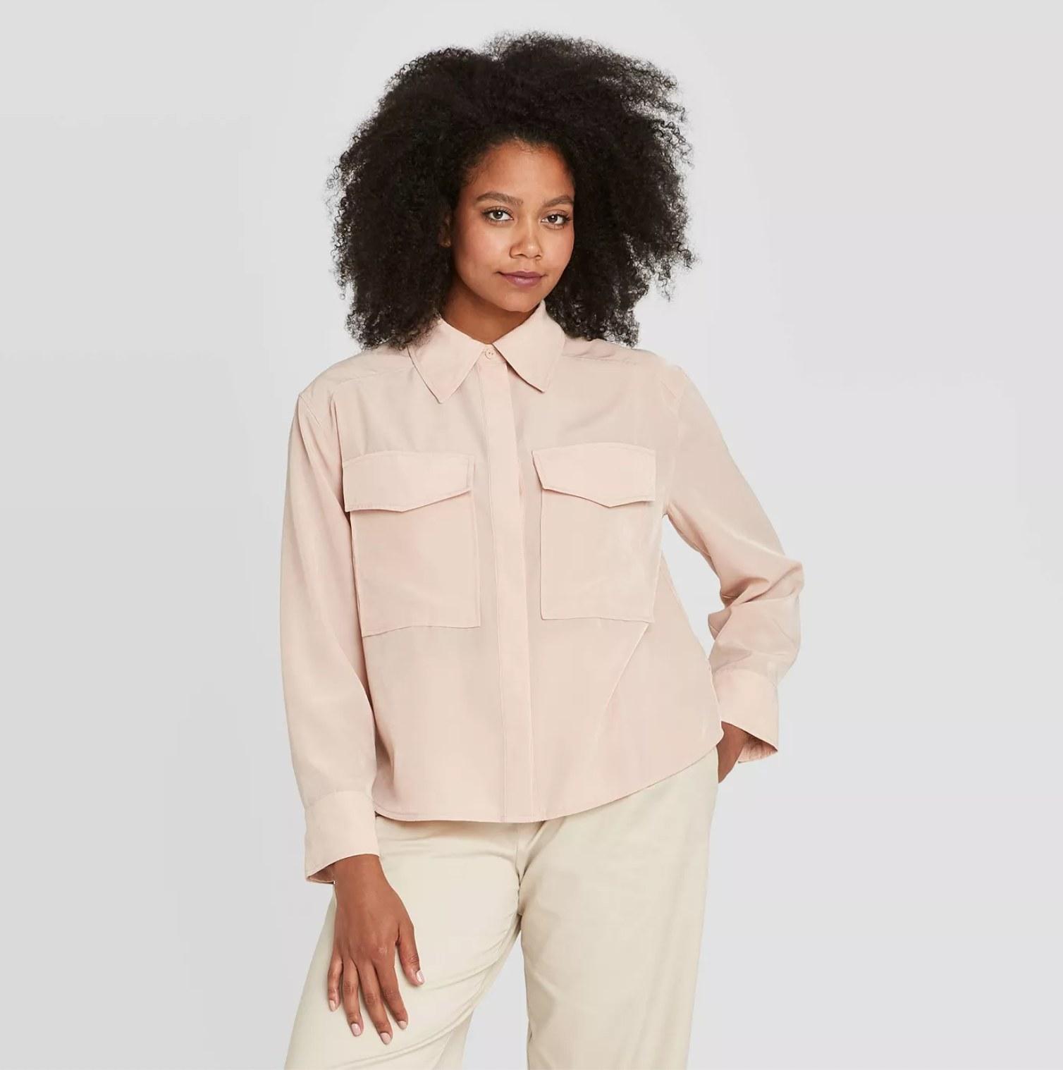 Model wearing the shirt in blush