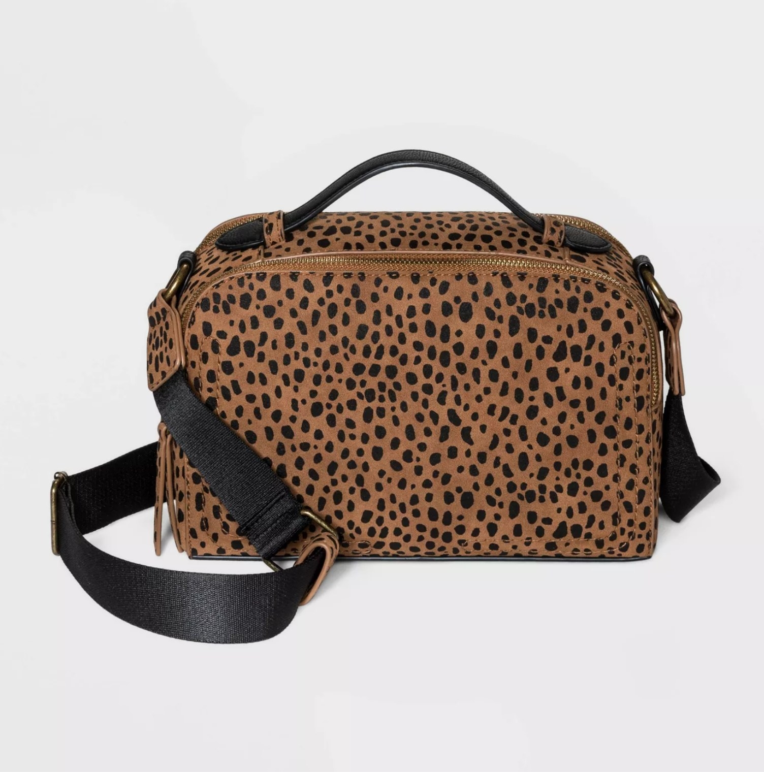 The bag in brown with black polka-dots
